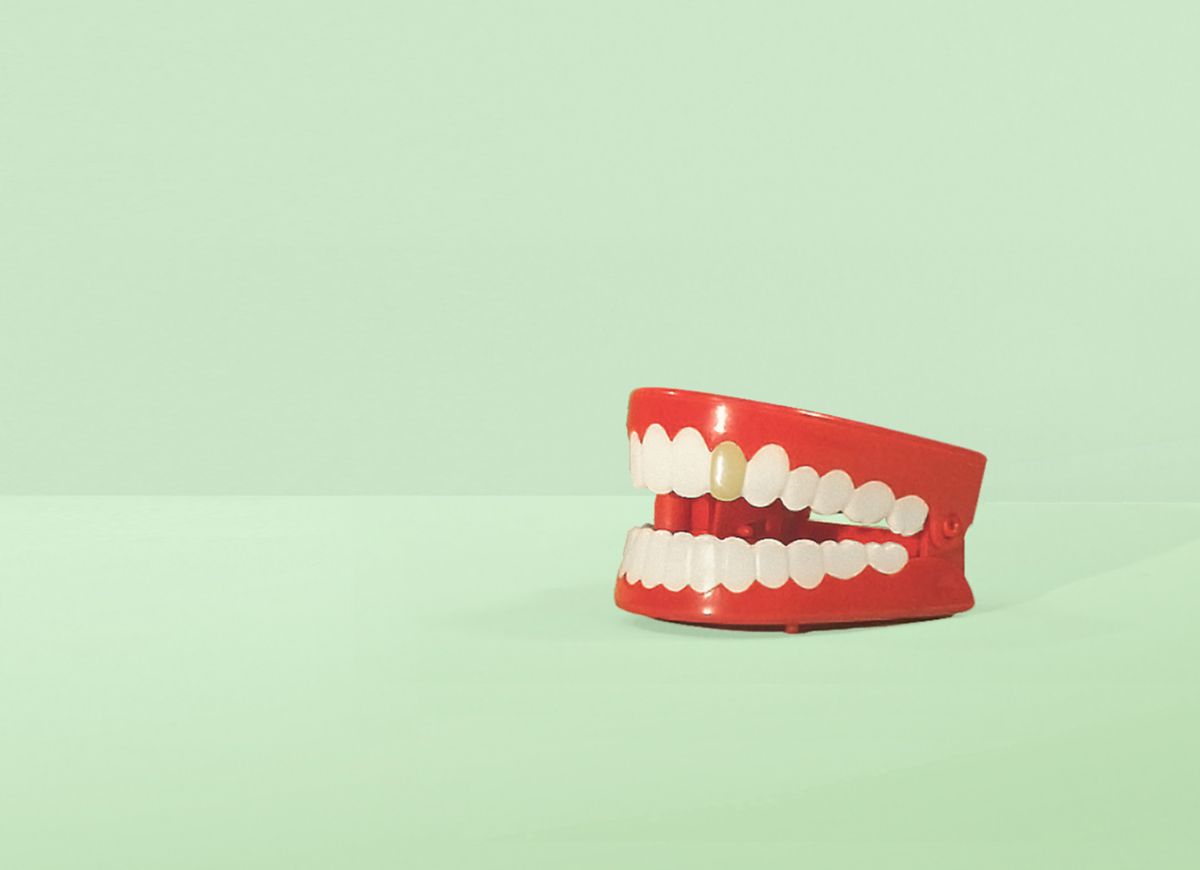 Brands to life_toy chattering teeth on green background