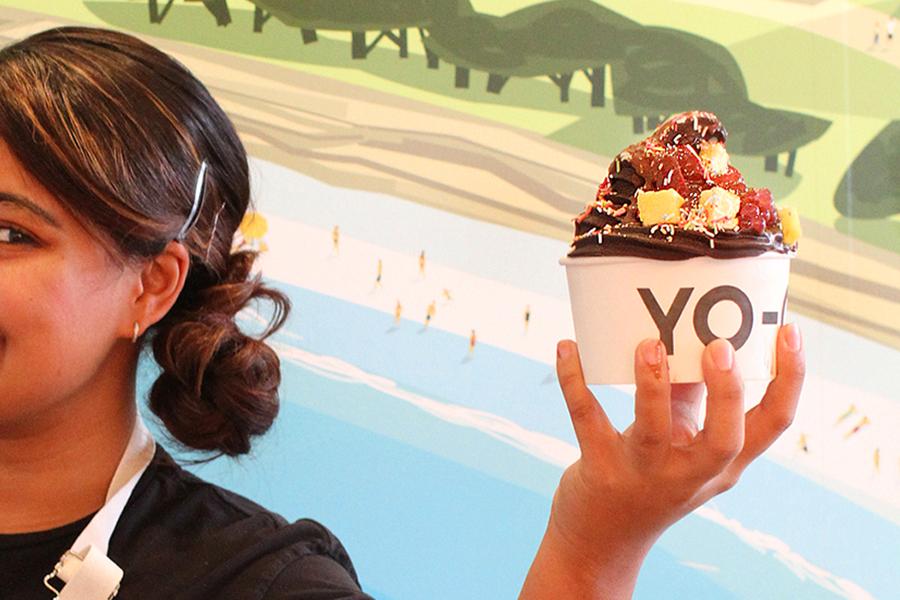 Yo-Chi - Girl holding chocolate frozen yogurt