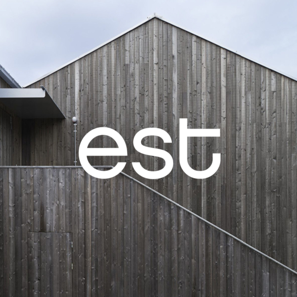 est branding brand mark over a timber architectural image