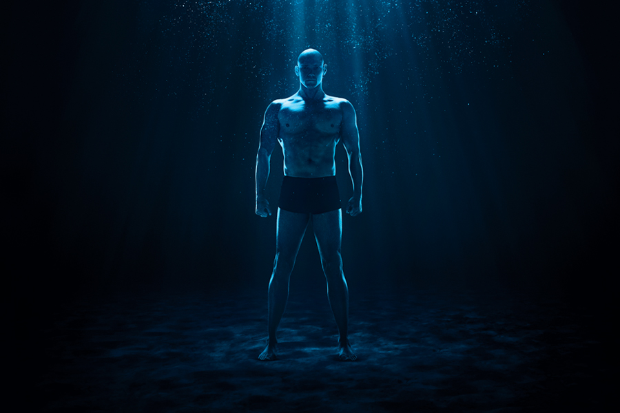 Michael Klim - Klim Deep Blue Brand Advertising full body shot of Michael Klim immersed in water