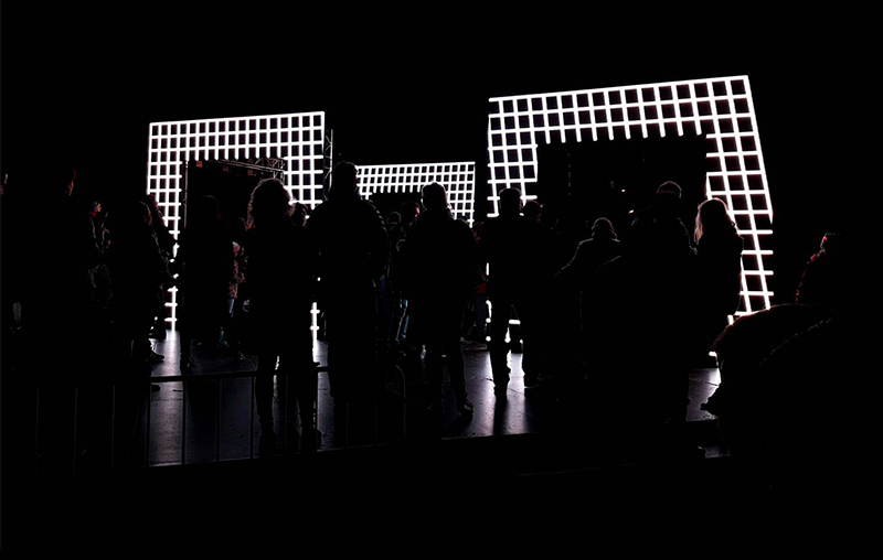 Sensory Underground - Silhouette of People looking at Light