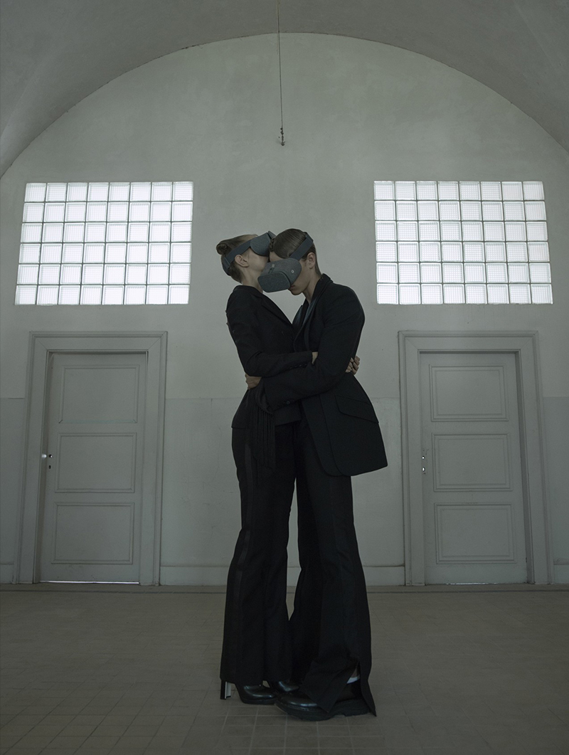 Two Women Wearing VR Goggles Hugging