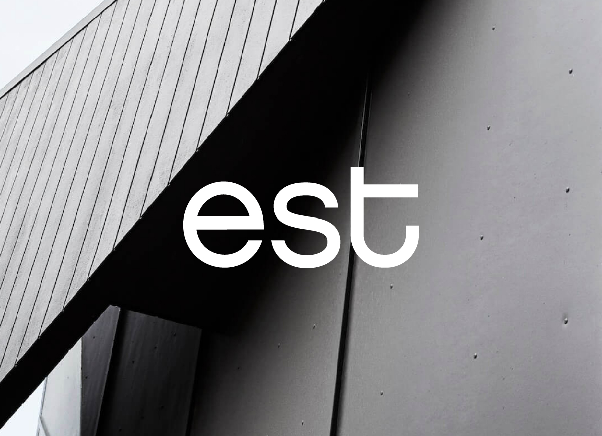 est brand mark over a timber and metal architectural image