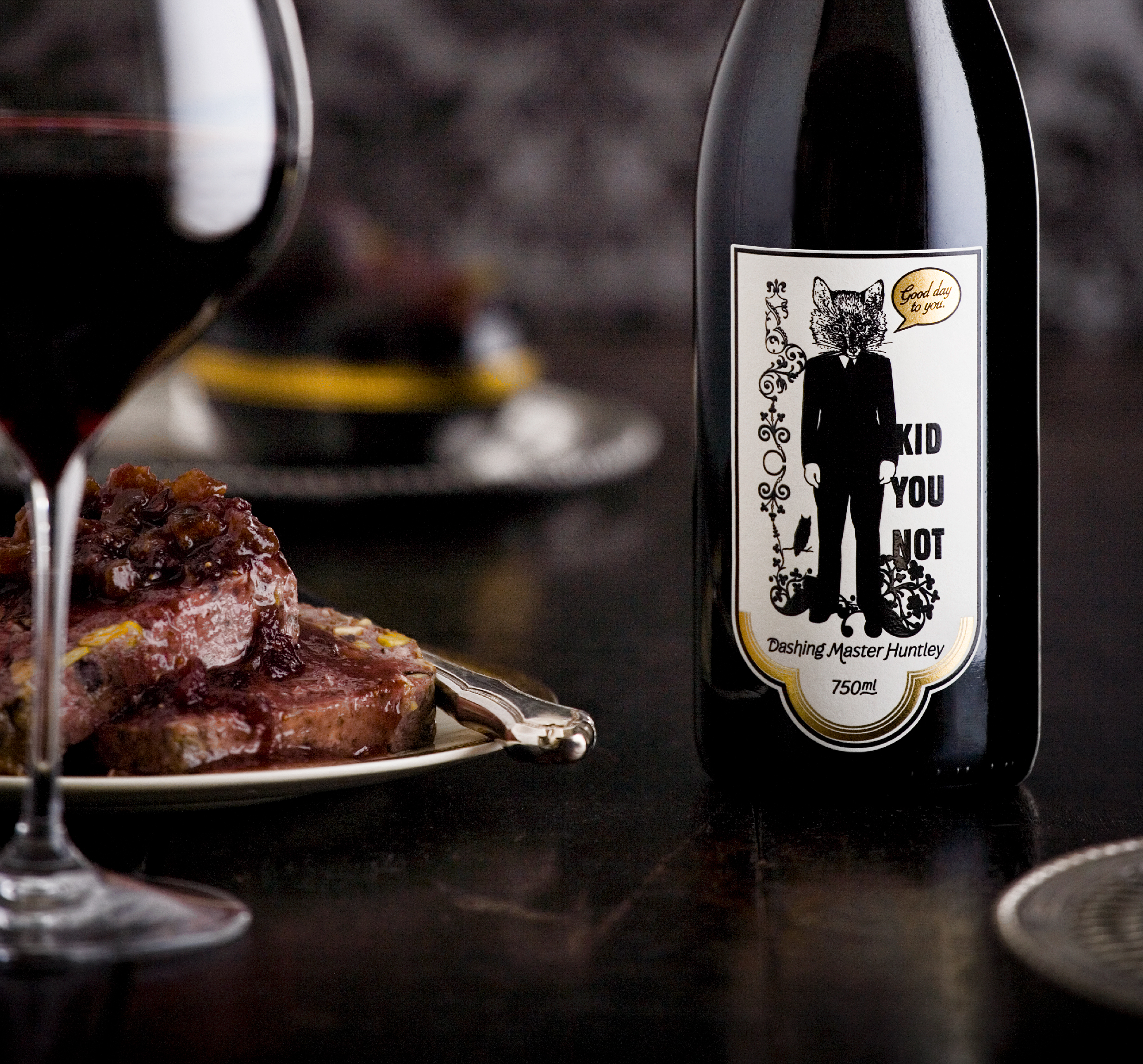 kid you not brand packaging red wine label on table with steak and glass